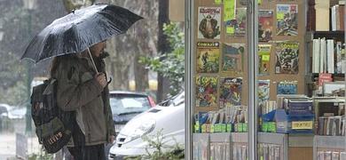 FOTO.Feria con lluvia