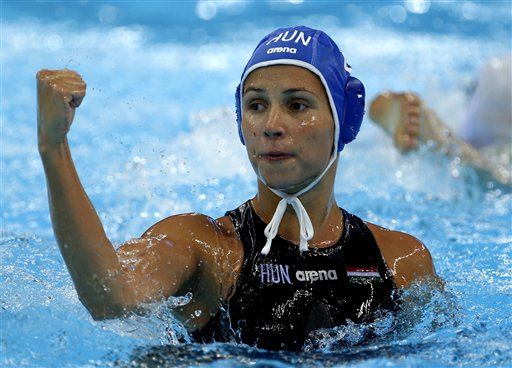Rita Keszthelyi of Hungary reacts after scoring a goal against Australia during the bronze medal women's water polo match at the 2012 Summer Olympics, Thursday, Aug. 9, 2012, in London. (AP Photo/Julio Cortez)